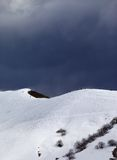Off-piste slope and overcast gray sky in windy day Royalty Free Stock Photo