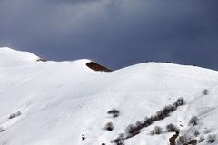 Off piste slope and overcast sky Stock Photos