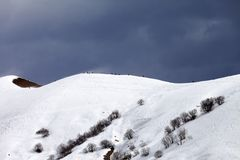 Off piste slope and overcast sky in windy day Stock Image