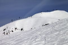 Off-piste slope and ropeway against blue sky Royalty Free Stock Photo
