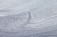 Off-piste slope and snowy road with trace from ski and snowboard Royalty Free Stock Photography