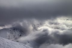 Off-piste slope and snowy rocks in bad weather Royalty Free Stock Photos
