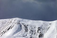Off-piste slope and storm gray clouds Stock Images