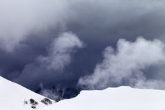Off-piste slope and storm gray clouds Royalty Free Stock Photos