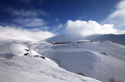 Off-piste slope at sun morning Royalty Free Stock Photography