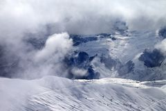 Off-piste slope in sunlight clouds Stock Photo