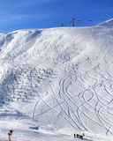 Off-piste slope with trace from ski and snowboard at sun morning Royalty Free Stock Photography