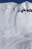Off piste slope with trace of skis, snowboarding and avalanche Stock Photos