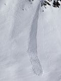 Off piste slope with trace of skis, snowboarding and avalanche Stock Photo