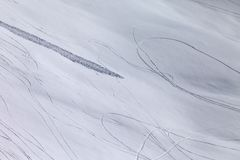 Off piste slope with traces of skis, snowboarding and avalanche Royalty Free Stock Images