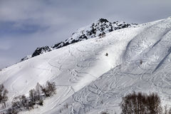 Off-piste slope with traces from skis and snowboards Stock Images