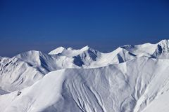 Off-piste slope with traces of skis and snowboards in nice day Royalty Free Stock Image