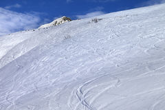 Off-piste slope with track from ski and snowboard in sunny morni Royalty Free Stock Photography