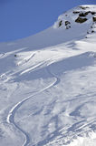 Off-piste snowboard track. In sunset light Royalty Free Stock Photos