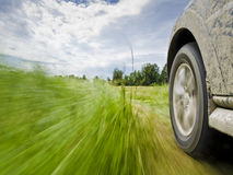 Off-raod car driving. Motion blur shot of a off-road car driving Royalty Free Stock Image