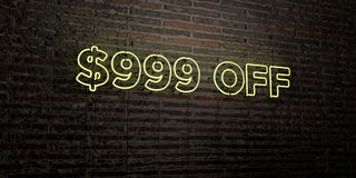 $999 OFF -Realistic Neon Sign on Brick Wall background - 3D rendered royalty free stock image. Can be used for online banner ads and direct mailers Royalty Free Stock Photo