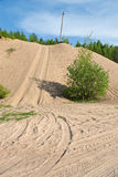Off-road. Tracks on sand and sand hill in countryside Royalty Free Stock Photography