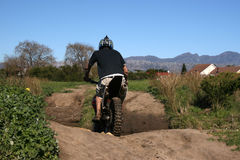 Off-road. Biker on a muddy course Stock Photos