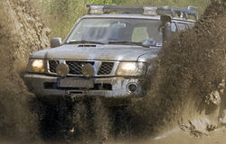 Off road action. 4x4 car during passing mud part of  special section off road track Stock Photos