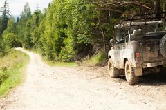 Off road 4x4 adventure, jeep on mountain dirt road. Copy space for text royalty free stock image
