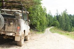 Off road 4x4 adventure, jeep on mountain dirt road. Copy space for text.  royalty free stock photo