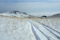 Off-road adventure. motor road laid through the deep snow in the desert. morning landscape. Stock Images