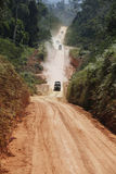 Off road adventure  with SUV car in rainforest Royalty Free Stock Photo