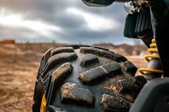 Studded wheel ATV backlit stock images