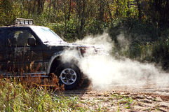 Off-road autumn trip #1. Off-road car with boiling engine on path during autumn forest trip Stock Photo