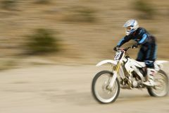 Off Road Biker Riding The Motor Bike Stock Photography