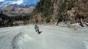 Off-road on bikes in Himalayas. Bike on mountain road in Himalayas. Off-road on bikes in Himalayas stock footage
