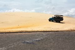 Off road blue truck going up a sand dune royalty free stock images