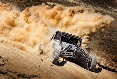 Off Road Buggy Race with Dust Plume Stock Photo