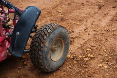 Off road buggy tire on dirt road. Off road buggy tire on wet dirt road Stock Photography