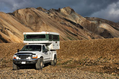 Off-road camper. Beautiful mountains in Iceland. Famous volcanic area with rhyolite rocks - Landmannalaugar. Off-road recreational vehicle. Camper jeep Royalty Free Stock Photo