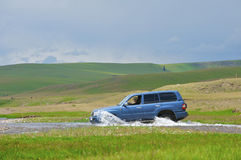 Off-road car. Crossing the river in mountains Stock Photography