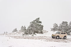 Off-road car. (with removed trademarks) on winter landscape Stock Photos
