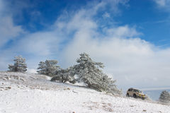 Off-road car. (with removed trademarks) on winter landscape Stock Photography