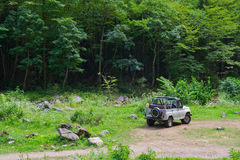 Off-road car. Russian off-road car in a clearing in the woods Stock Images
