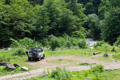 Off-road car. Russian off-road car in a clearing in the woods Royalty Free Stock Photography
