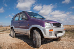 Off road car against bright cloudy sky. Crossover ,SUV car Royalty Free Stock Images