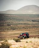 Off-road car against mountains. Off-road car on the road against  a mountain landscape Royalty Free Stock Image