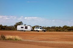 Off road car with air intakes and a white caravan trailer in Western Australia. White off road car with air intakes and a white caravan trailer in Western stock photography