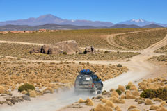 Off-road car at Atacama Desert in Bolivia Stock Photos