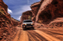 Off road car in the Canyon. Off road vehicle goind down the hill between Pucker Pass and Giant fallen rock Stock Photo