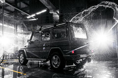 Off-road car at the carwash Back view stock photography
