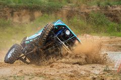 Off-road car crossing mud obstacle Royalty Free Stock Photo