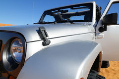 Off-road car on desert. Silver off-road  car in sands of Arabia under blue sky Stock Photography