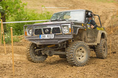 Off-road car in difficult muddy terrain Stock Photo