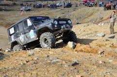 Off-road car in difficult terrain Stock Photos